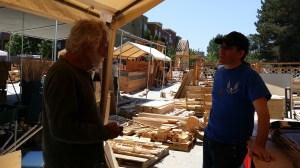Tempe designer David Best talks with Temple Guardians head Carousel at Temple build site in Petaluma, CA