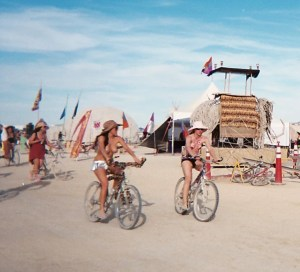 A day on the Playa -- clothing may be optional, but a bike is a must.