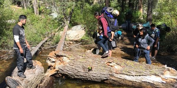 Backpacking across creek