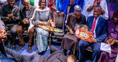 Anthony Joshua prostrates to presents Heavyweight titles to Buhari In UK (Photos)