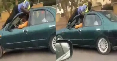 Moment a Nigerian Police officer climbs the roof of a moving car (video)