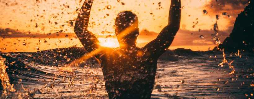 silhouette photography of man at beach during sunset