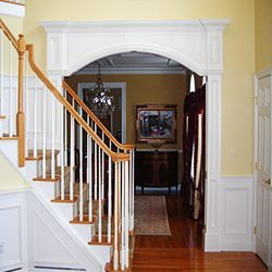 Fancy archway with wainscot in Foyer