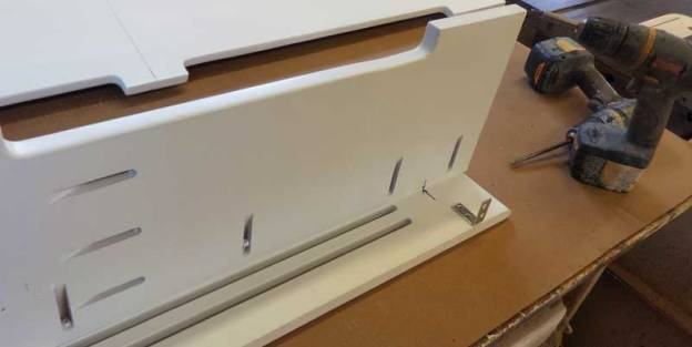 Assembled section of a wood baseboard heater cover