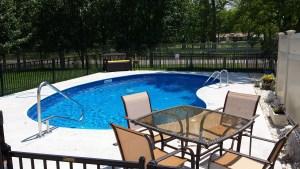 Vinyl liner pool with custom fence