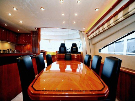 The 82 Yacht also features a semi-enclosed Galley, adjacent to the Dining area