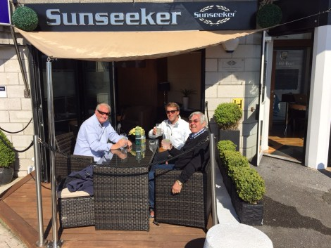Clients enjoy a Berkeley Square G&T with Tom Wills on the Sunseeker Torquay decking