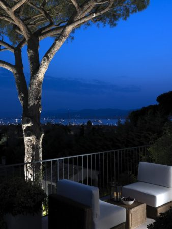 Mediterranean view at night from terrace at Villa Armani Casa