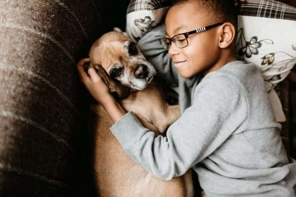 Boy hugging dog - Clogged Drain Line - Fort Myers - Sunset Air & Home Services