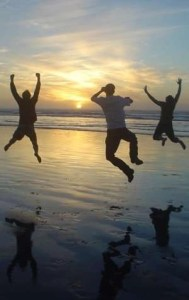 Family jumping on beach– AC Maintenance Agreement - Fort Myers - Sunset Air & Home Services