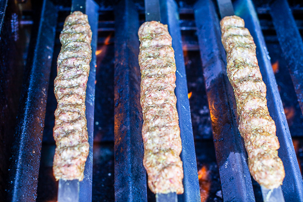three kebabs placed over medium-hot flame cooking