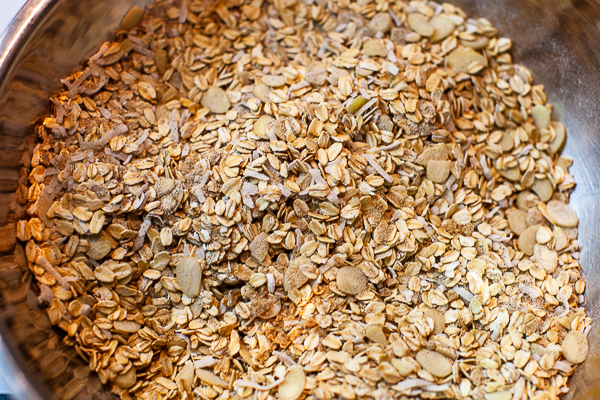 mixing bowl containing oatmeal and dry ingredients mixed together