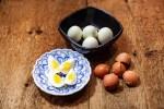 Hard boiled eggs in black dish