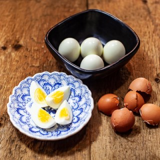 Hard boiled eggs in black dish