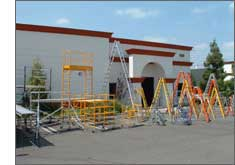 Sunset ladder and scaffolding products in yard.