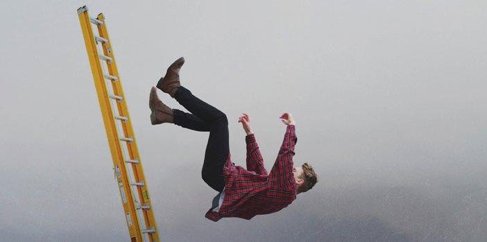 man falling off construction ladder