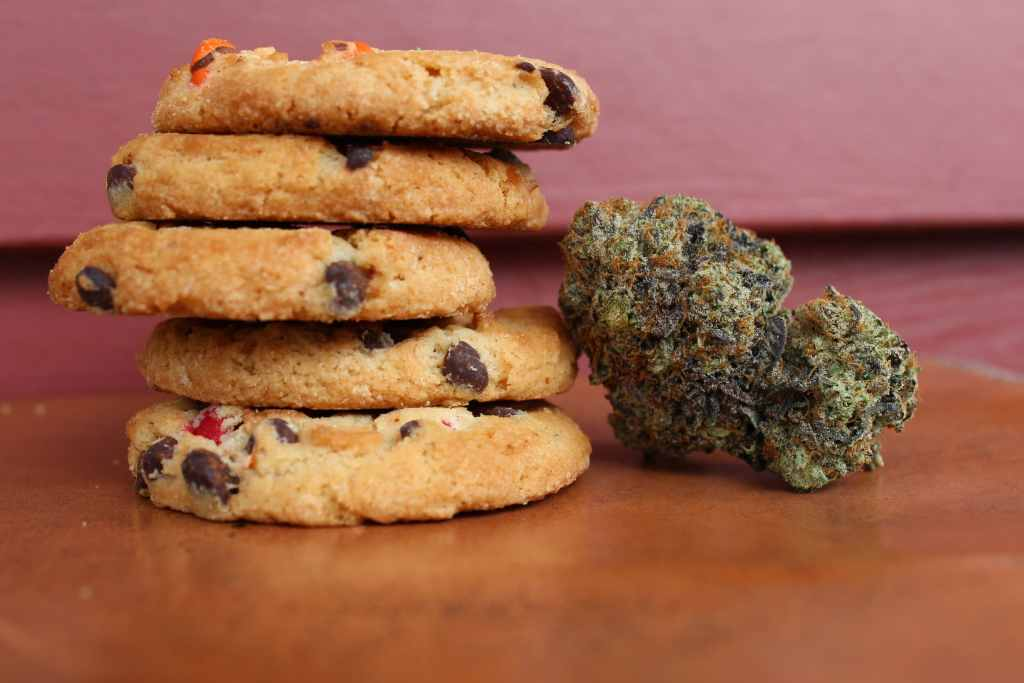 Cannabis next to a stack of cookies