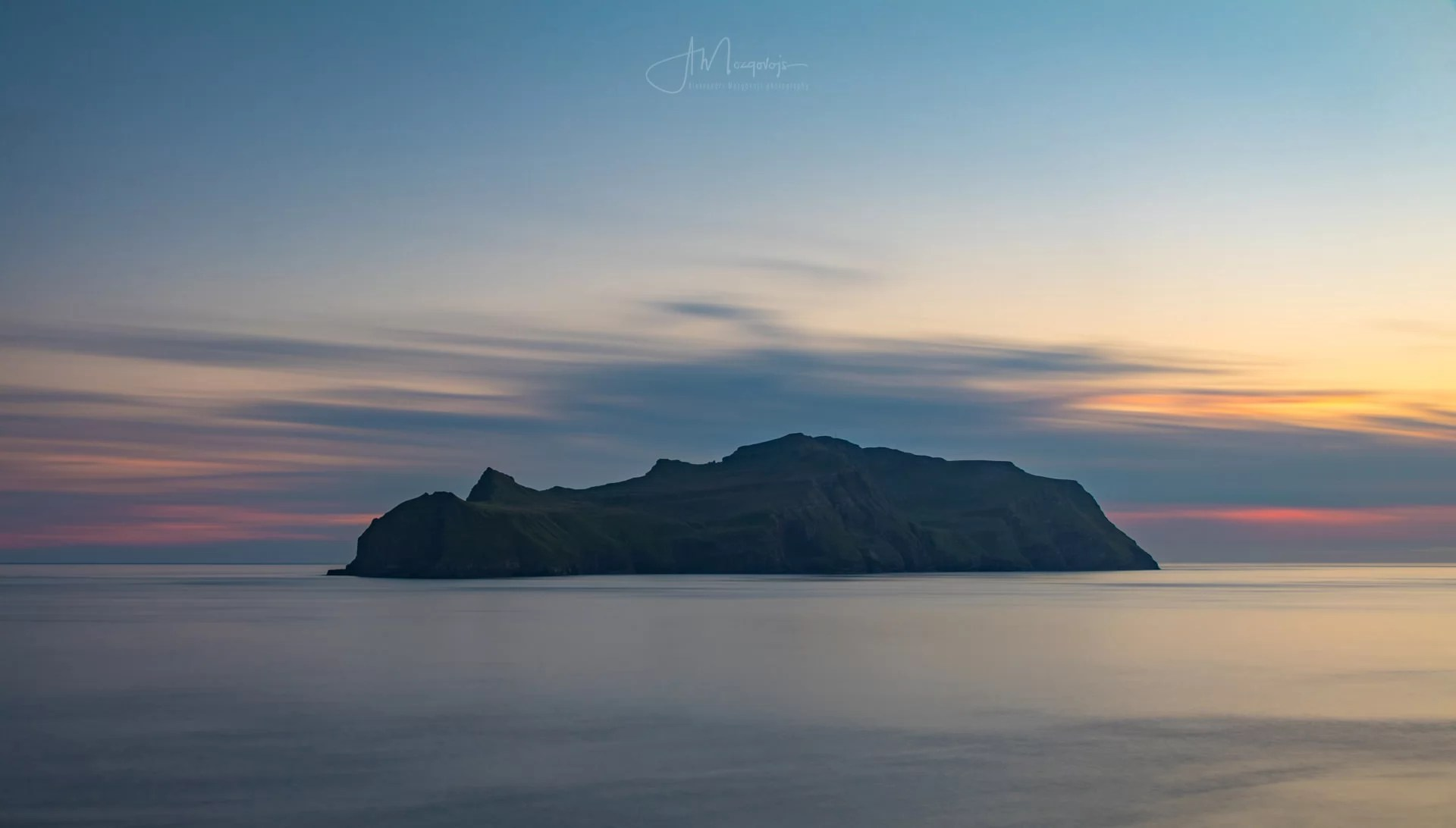 Sunset view of Mykines from Vágar