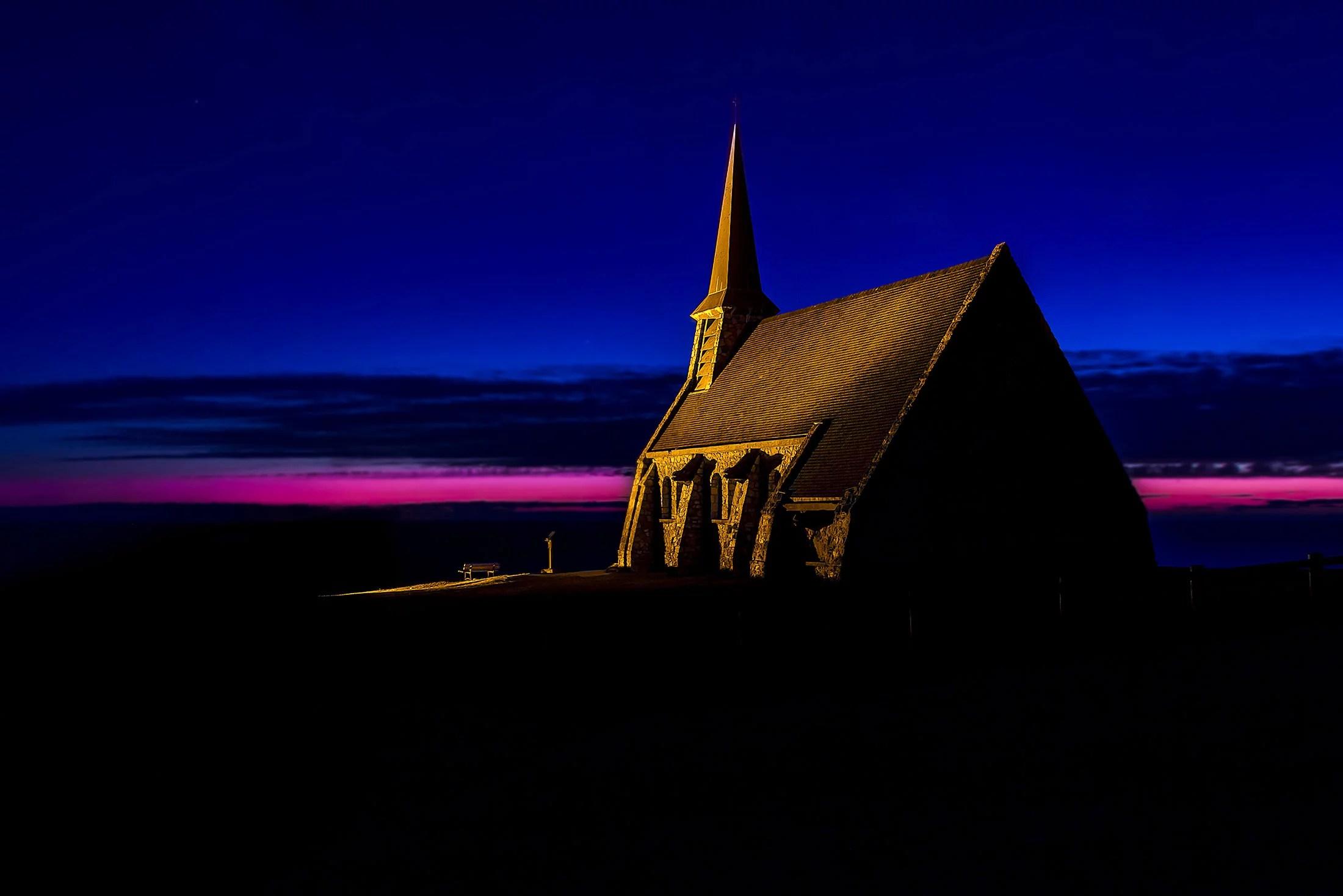 Blue hour view of the Notre-Dame chapel in Étretat