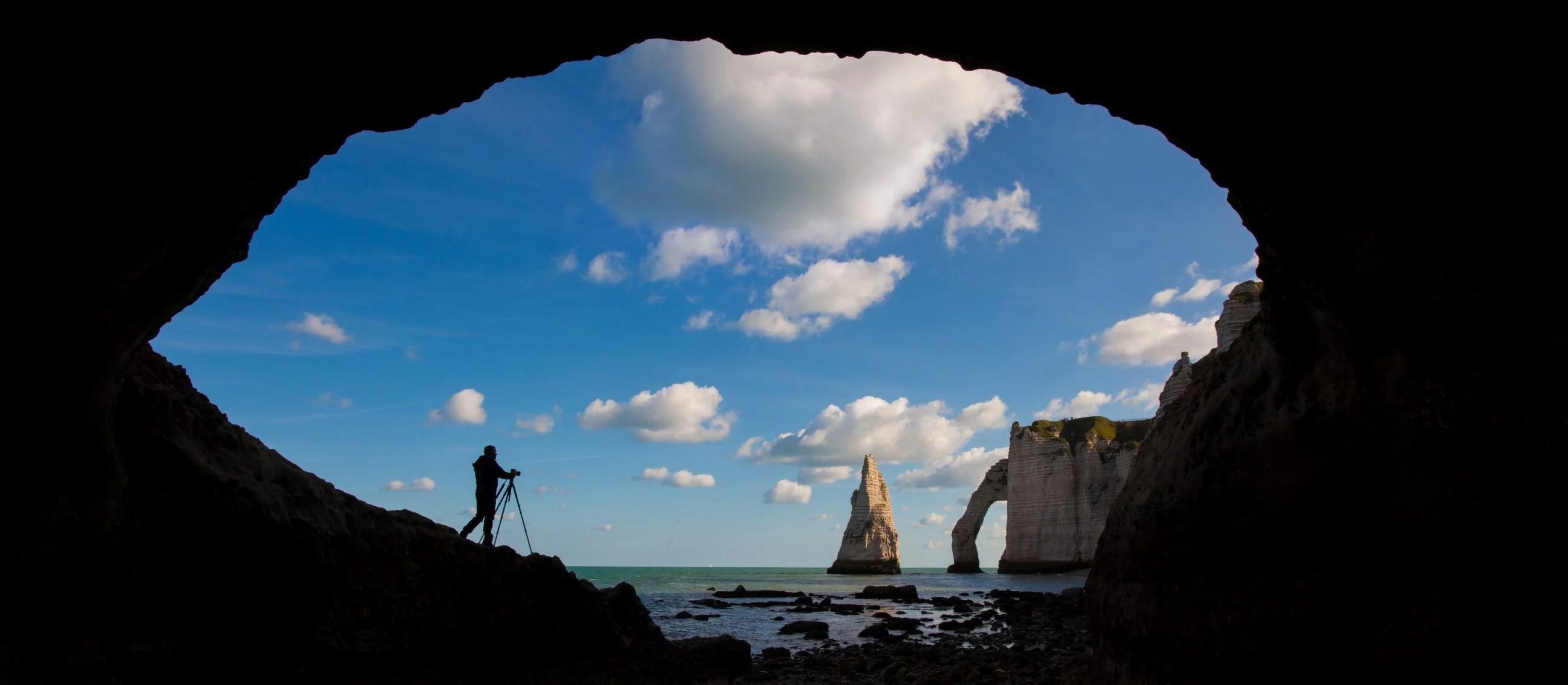 Landscape photographer at work in Étretat