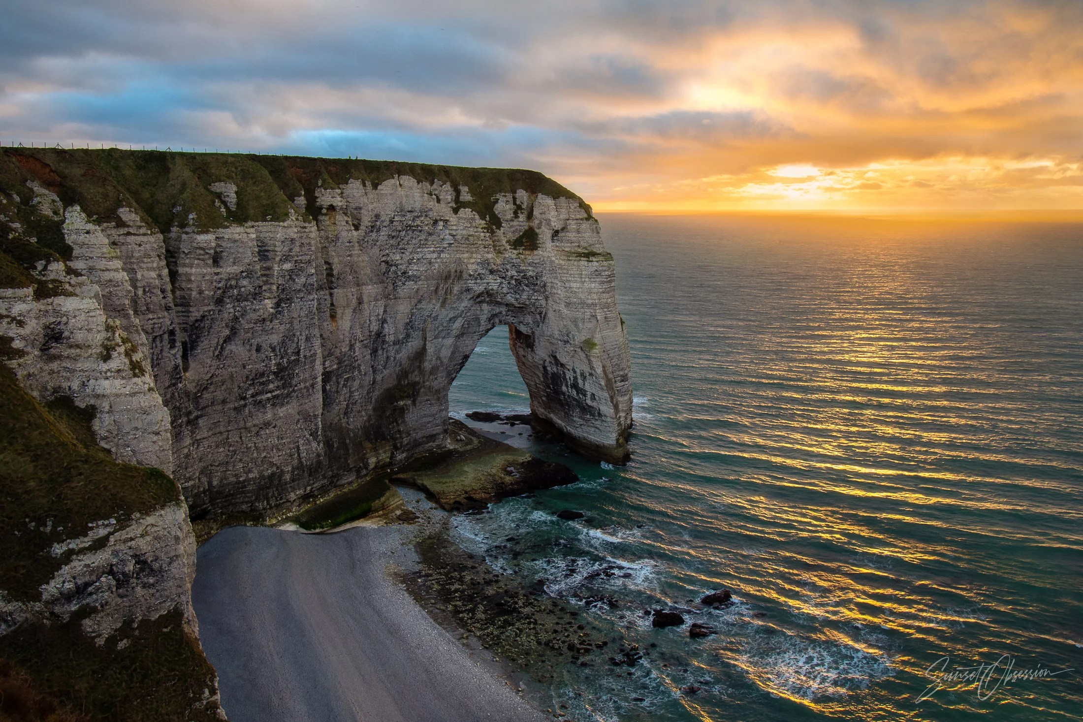 Sunset view of Manneporte arch from the top of Porte d'Aval, Etretat, Normandy, France