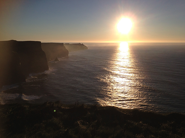 Sunset over water at Cliffs of Moher, Ireland