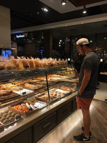 Tom daydreaming over pastries