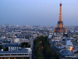 The Eiffel Tower lights up, Paris
