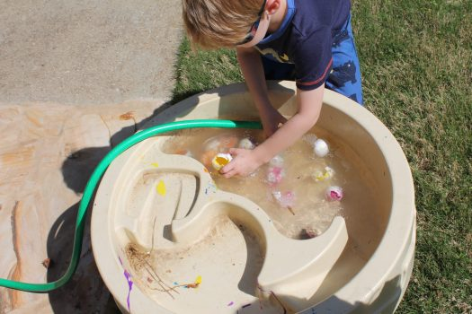paint-filled egg toss easter activity