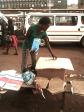 Vendor preparing her stall