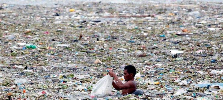 Man in ocean of plastic