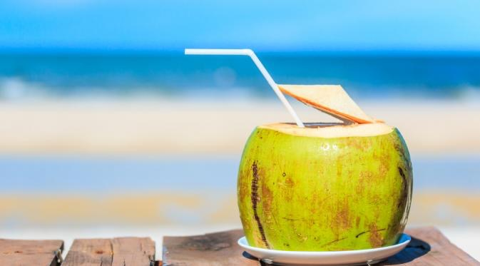 going nuts for fresh c-o-c-o-n-u-t water coconut by the beach