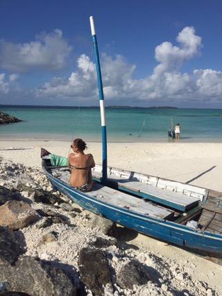 Girl on boat facing the sea in Maafushi Island Maldives