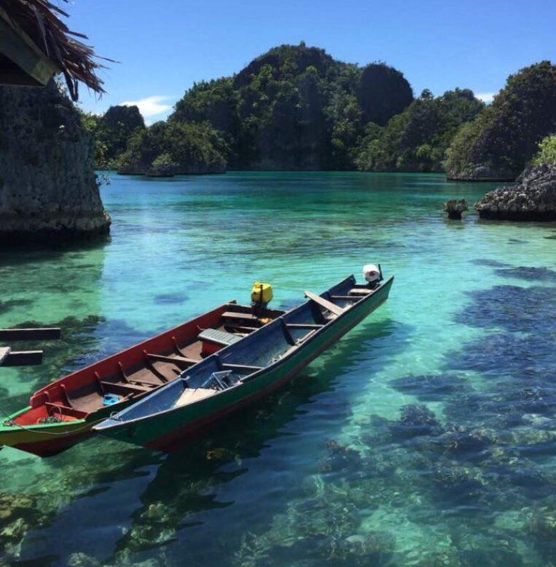 different colours of the sea - sampan in raja ampat, indonesia