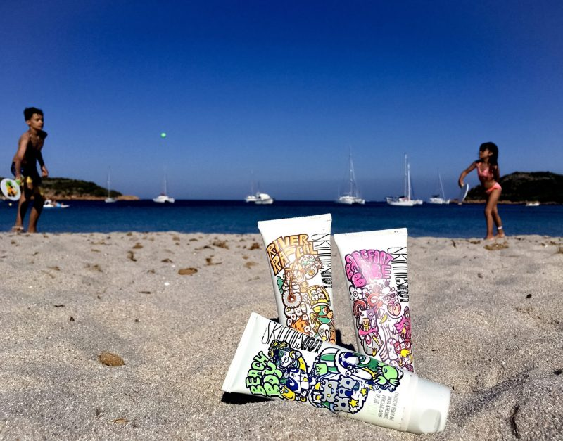 sunscreen for babies and kids - skinnies kids -children playing paddle on beach