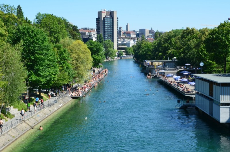View of Oberer Letten Canal in Limmat River with Zurich city in the background-best rivers in switzerland safe for swimming