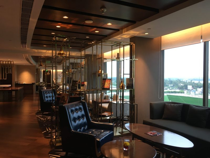 elegant seating areas of the grand club lounge with views of kochi