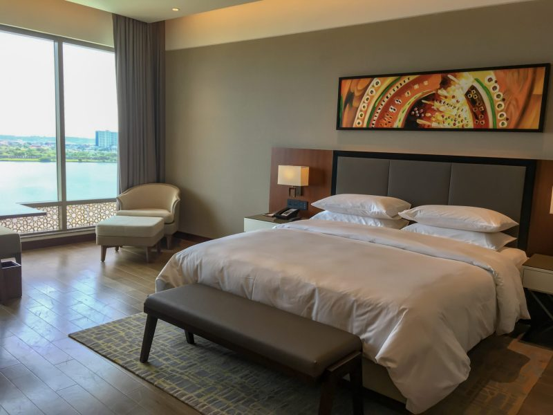 king bed inside the grand room with view of kochi