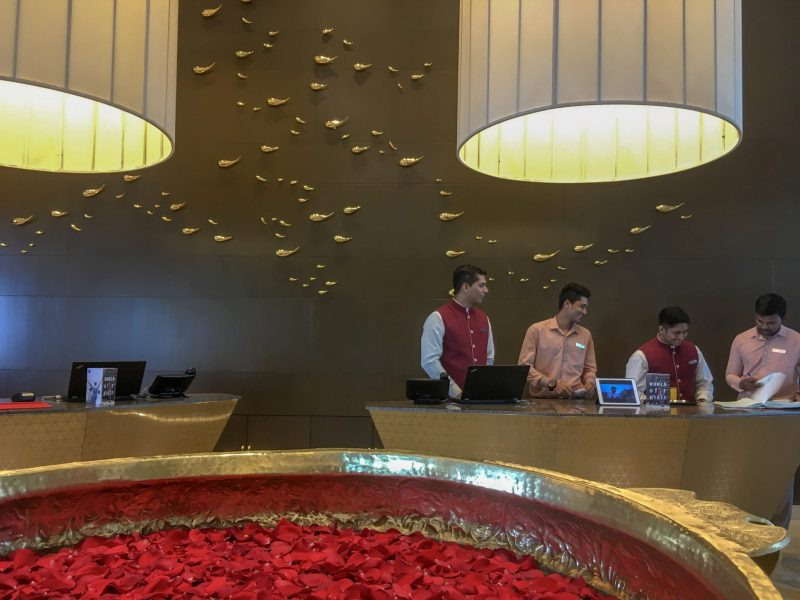 group of receptionist at the hotel lobby smiling