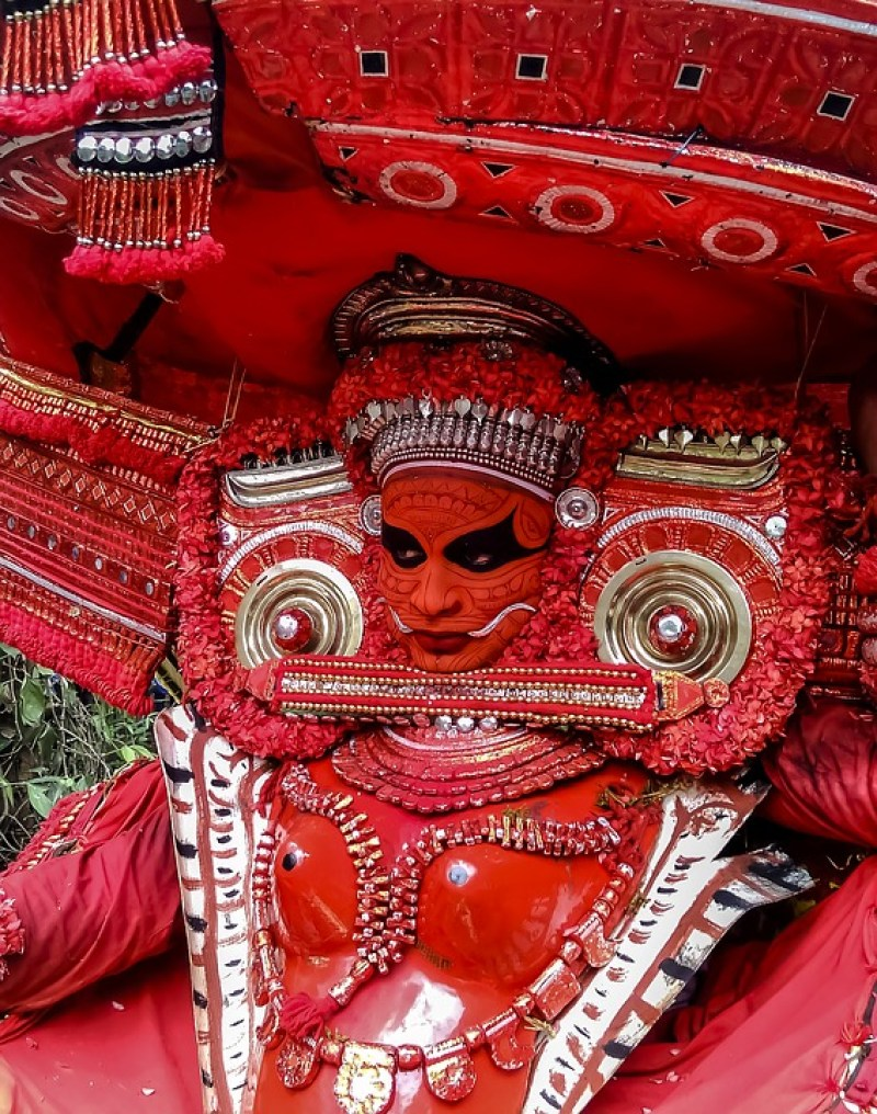 Theyyam performance full costume in red makeup