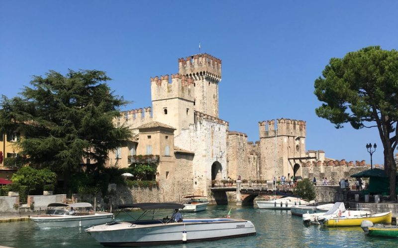 scaliger castle and port of sirmione with boats