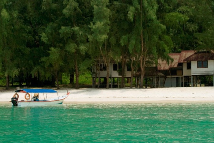 Island Hopping in Langkawi, Malaysia, Pulau Beras Basah beach with boat and trees