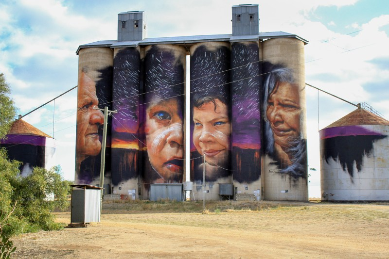 art mural painting of people on silos in victoria