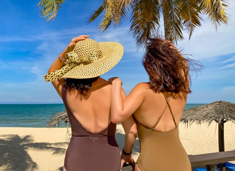 mother daughter in luxury swimwear for modern moms by the beach in malaysia