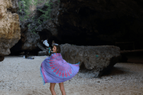 Tegan spinning around on the sand with a sarong