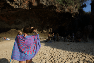 Tegan with a sarong over her standing in the keyhole at uluwatu