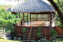 Big wooden bali style yoga hut on the lawn
