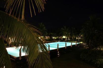 The massive swimming pool light up at night