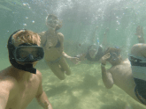 Underwater group selfie