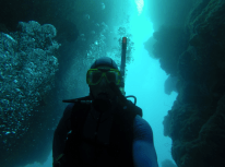 Selfie while swimming through a narrow cave of coral